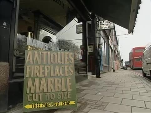 A still from the video showing a sign for free parking at the rear of the antiques shop.