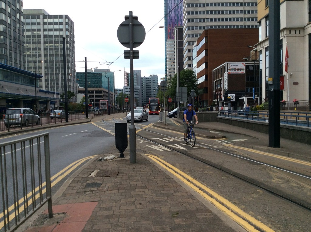 A cyclist taking the most pragmatic - albeit risky - route up Wellesley Road